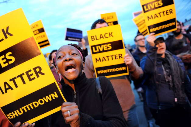 "Regina Burns of Albany chants ""Black lives matter"" during a rally outside Albany police south station on Friday, April 3, 2015, in Albany, N.Y. Citizens gathered to protest the death of Donald ""Dontay"" Ivy, the 39-year-old man who died after he was shocked with a stun gun and struggled with police. (Cindy Schultz / Times Union) ORG XMIT: MER2015040322064112 Photo: Cindy Schultz / 00031291A"