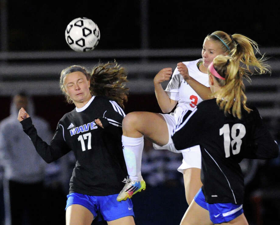 Darien's Margaret Skeats (#17) battles for the ball with Greenwich's Treloara Harrisson and Katherine Cronin during the Blue Wave's 1-0 victory on Friday in Greenwich. Photo: Bob Luckey Jr. / Hearst Connecticut Media / Greenwich Time