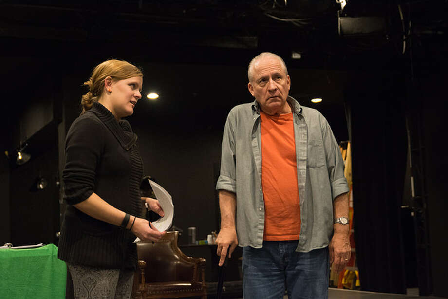 """Capital Region actors Amie Lytle as the Reverend Abigail and Ron Komora as her curmudgeonly parishioner, Lloyd, in rehearsal for WAM Theatre's upcoming production of """"Holy Laughter"""" by Catherine Trieschmann, directed by Megan Sandberg-Zakian. Photo credit: Enrico Spada"""