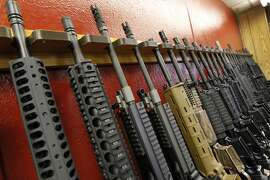 FILE - In this July 20, 2012, file photo, a row of different AR-15 style rifles are displayed for sale at the Firing-Line indoor range and gun shop in Aurora, Colo. After a steady string of mass shootings and a revival of the political fight over gun control, Americans are slightly more likely than they were two years ago, in 2013, to say gun laws should be made stricter, a new Associated Press-GfK poll found.  (AP Photo/Alex Brandon, File)