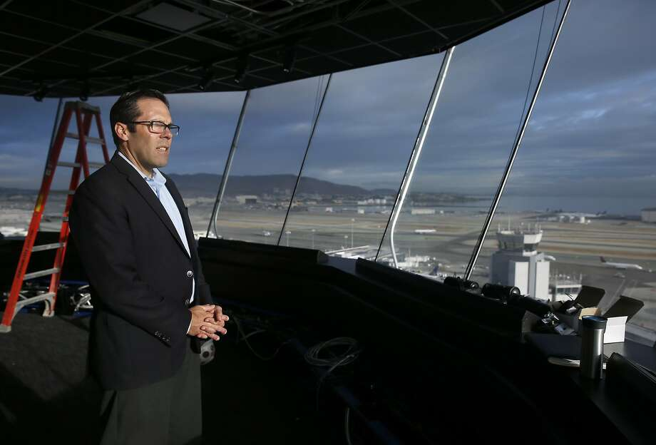 Mark Costanzo, construction project manager for SFO, takes in the sweeping view of the runways from the new air traffic control tower in San Francisco, Calif. on Wednesday, Oct. 28, 2015. The state-of-the-art 221-foot tower will replace the older and shorter version when it becomes fully operational in July 2016. Photo: Paul Chinn, The Chronicle