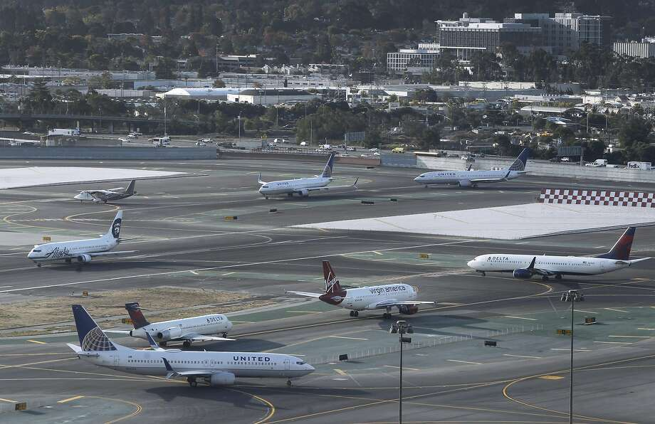 Jetliners guided into position for takeoff by air traffic controllers can be seen from the new control tower at SFO in San Francisco, Calif. on Wednesday, Oct. 28, 2015. The state-of-the-art 231-foot tower will replace the older and shorter version when it becomes fully operational in July 2016. Photo: Paul Chinn, The Chronicle