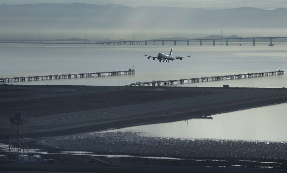 A 747 jumbo jet preparing to land on runway 28L can be seen from the new air traffic control tower at SFO in San Francisco, Calif. on Wednesday, Oct. 28, 2015. The state-of-the-art 231-foot tower will replace the older and shorter version when it becomes fully operational in July 2016. Photo: Paul Chinn, The Chronicle