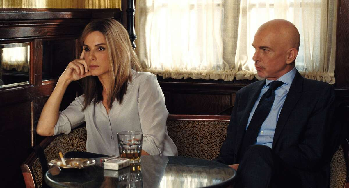 """This photo provided by Warner Bros. Pictures shows, Sandra Bullock as Jane and Billy Bob Thornton as Pat Candy, in Warner Bros. Pictures and Participant Media's satirical comedy """"Our Brand Is Crisis,"""" a Warner Bros. Pictures release. The movie opens in U.S. theaters on Oct. 30. (Warner Bros. Pictures via AP)"""