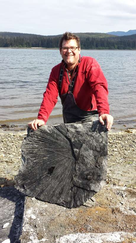 "Renowned paleontologist Kirk Johnson with a huge fossil at Hamilton Bay discovered during the filming of the NOVA special ""Making North America."""