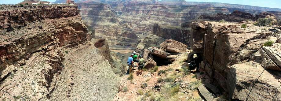 "Paleontologist Kirk Johnson rappelling down the Grand Canyon during the filming of the NOVA special ""Making North America."""
