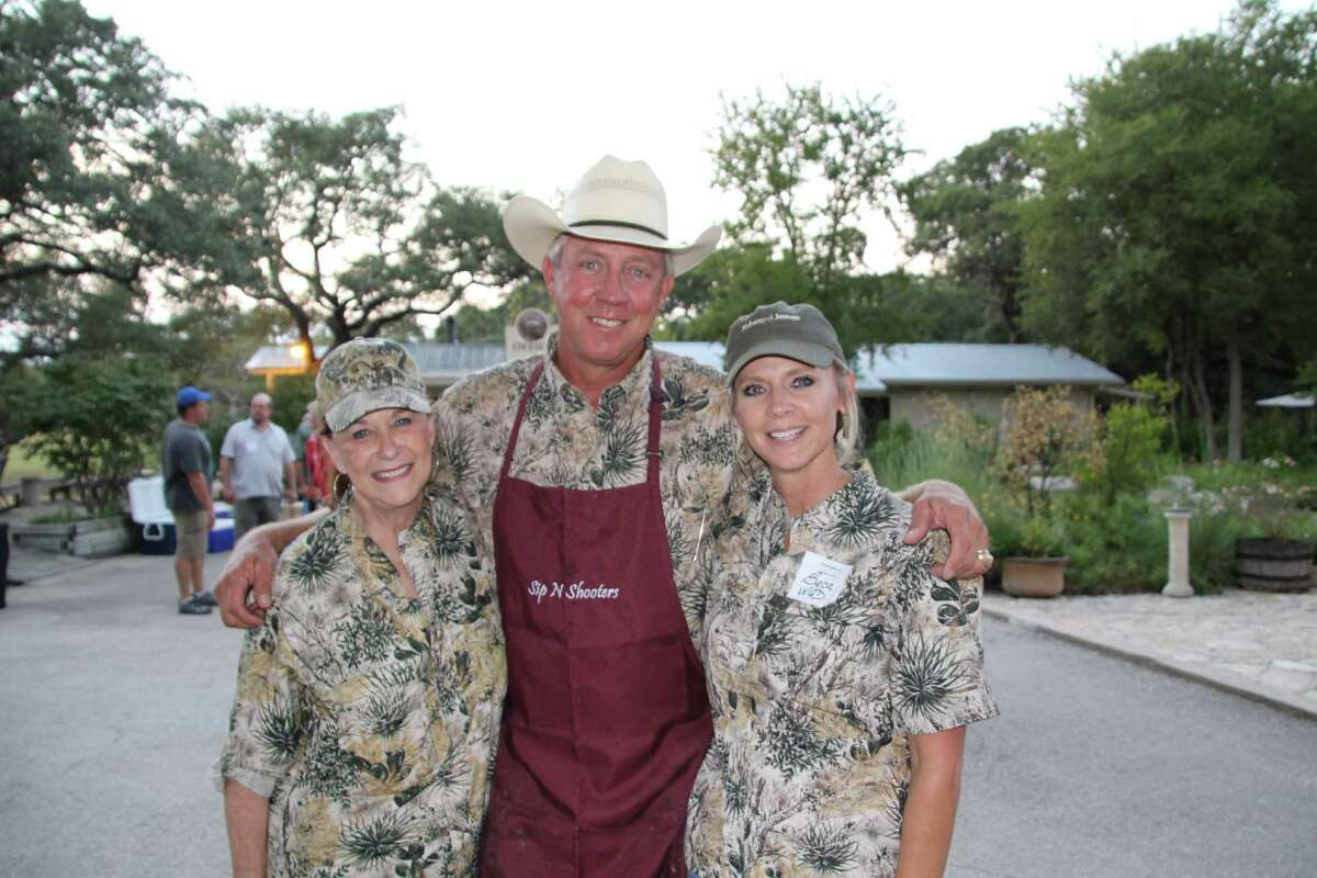 Karen Daly (left) and Beca Short are co-chairs for this year's Wild Game Dinner held at Kendall County Fairgrounds on Nov. 7. Dutch Short (center) is a member of the Sip-N-Shooters cook team.