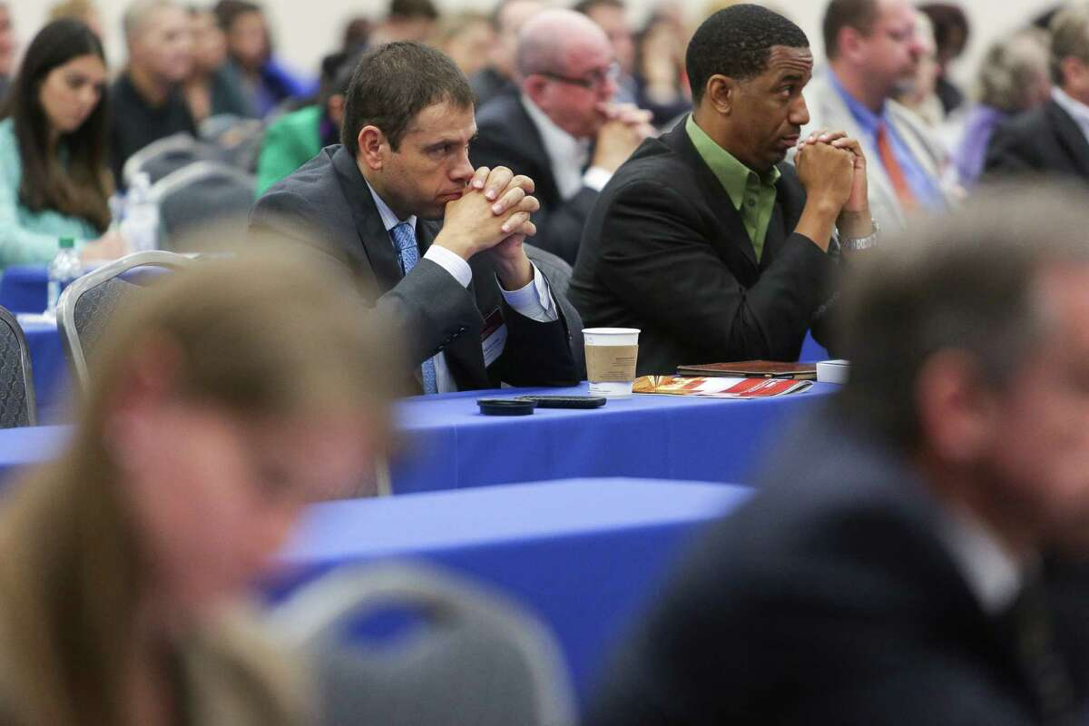 Kansas City Southern Railroad assistant vice president of sales and marketing Rafael Mercado, left, and Texas Southern University graduate student Larry Frost, right, listen to speakers at the Seventh Annual Harris County International Trade and Transportation Conference at the NRG Center Wednesday, Oct. 28, 2015, in Houston. (Michael Ciaglo / Houston Chronicle)
