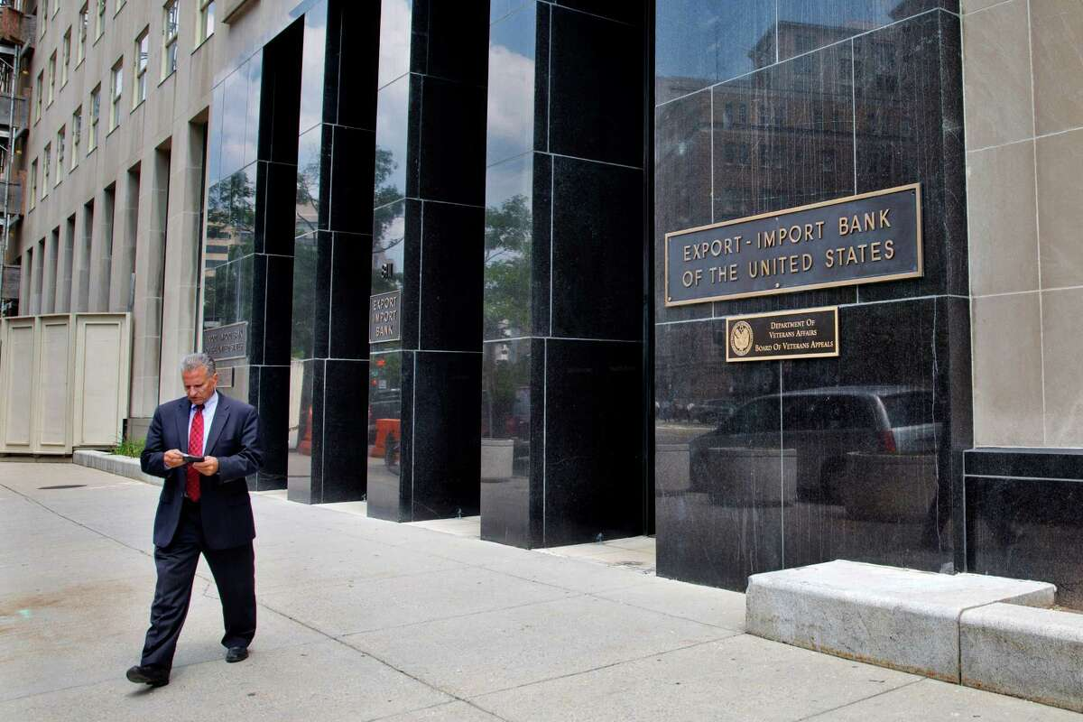 A man walks out of the Export-Import Bank of the United States in Washington. A strong coalition of establishment-backed Republicans and House Democrats voted overwhelmingly Tuesday to revive the Export-Import Bank.