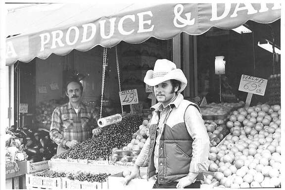 Gus Vardakastanis, right, and his father, Dimitri in front of their store Haight Street Produce around 1981.