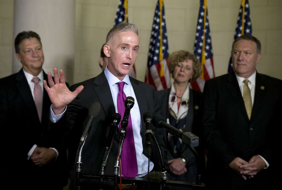 Rep. Trey Gowdy, R-S.C., chairmanof theHouse Select Committee on Benghazi, talks to the press after Democratic presidential candidate former Secretary of State Hillary Rodham Clinton testified on Capitol Hill in Washington, Thursday, Oct. 22, 2015, before the House Select Committee on Benghazi. Behind Gowdy are members of the House Select Committee on Benghazi from left, Rep. Lynn Westmoreland, Gowdy, Rep. Susan Brooks, R-Ind., and Rep. Mike Pompeo, R-Kan. (AP Photo/Carolyn Kaster) Photo: Carolyn Kaster, Associated Press