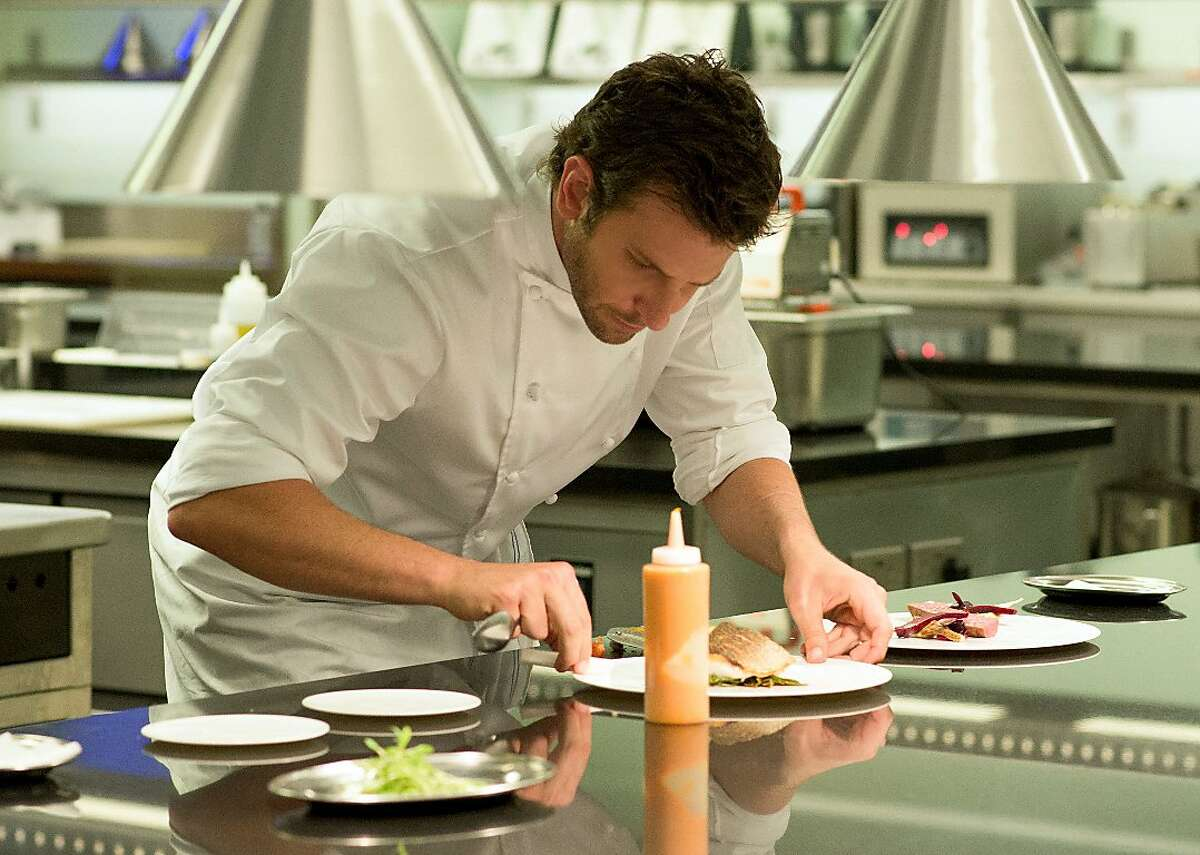 This photo provided by The Weinstein Company, shows Bradley Cooper as Adam Jones, in a scene from the film,