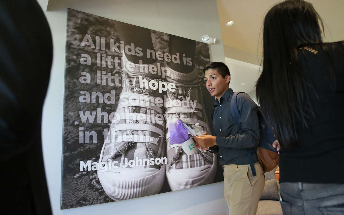 Blue Hess, who was a child at the Children's Shelter, quietly tours the new facility by himself during the grand opening of the Harvey Najim Hope Center at the Children's Shelter on Oct. 28. Hess was one of the featured speakers at ceremonies held just before the opening.