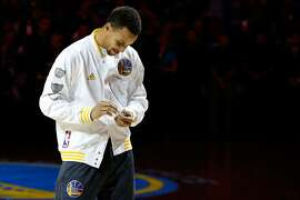 OAKLAND, CA - OCTOBER 27:  Stephen Curry #30 of the Golden State Warriors admires his championship ring prior to their game against the New Orleans Pelicans in the NBA season opener at ORACLE Arena on October 27, 2015 in Oakland, California. NOTE TO USER: User expressly acknowledges and agrees that, by downloading and or using this photograph, User is consenting to the terms and conditions of the Getty Images License Agreement.  (Photo by Ezra Shaw/Getty Images)