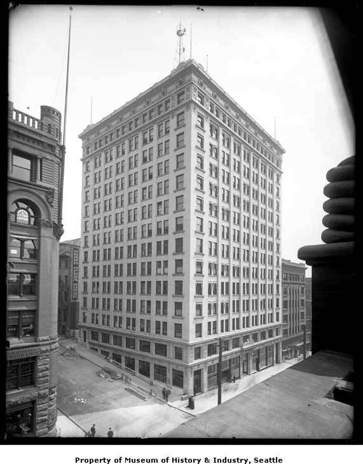 By 1904 the tallest structure was the Alaska Building (pictured here around 1907), at 203 feet tall. Photo by Webster and Stevens, courtesy MOHAI, PEMCO Webster & Stevens Collection, image number 1983.10.7317.1.