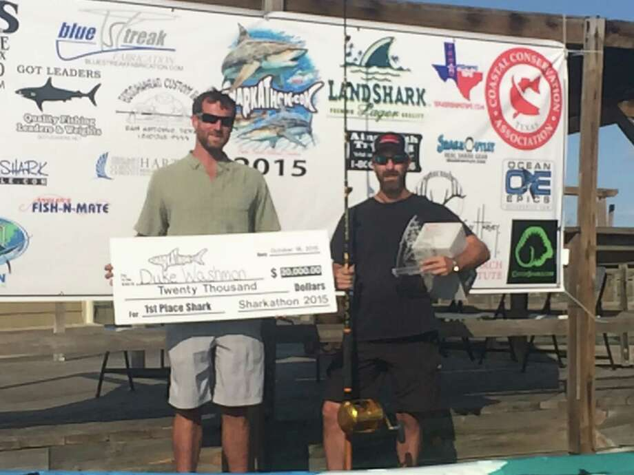 Blayne Mozisek, left, and Duke Washmon, right, stand to accept $20,000 earned in the 2015 Sharkathon competition. Photo: Courtesy/Duke Washmon