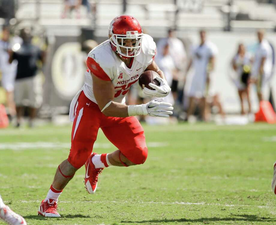 Houston running back Kenneth Farrow (35) runs against Central Florida during the second half of an NCAA college football game, Saturday, Oct. 24, 2015, in Orlando, Fla.  Houston won 59-10. (AP Photo/John Raoux) Photo: John Raoux, STF / AP