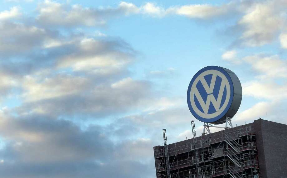 FILE - In this Sept. 26, 2015 file photo a giant logo of the German car manufacturer Volkswagen is pictured on top of a company's factory building in Wolfsburg, Germany. Volkswagen is reporting a loss of 1.67 billion euros (US dollar 1.83 billion) in the third quarter, Wednesday, Oct. 28, 2015, as earnings took a hit from 6.7 billion euros in set-asides for recalls and fines connected to cars rigged to evade U.S. diesel emissions testing. (AP Photo/Michael Sohn, file) ORG XMIT: LGL104 Photo: Michael Sohn / AP