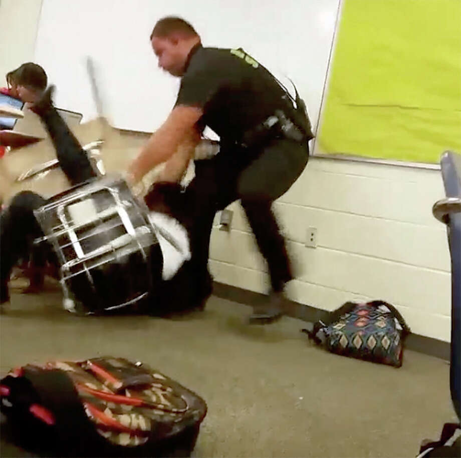 Senior Deputy Ben Fields was fired Wednesday after he flipped a disruptive student out of her desk who refused to leave her Columbia, S.C. high school math class.  Photo: HONS / Student