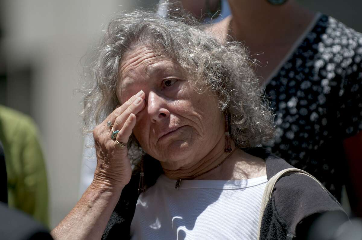 Susan Harman tears up as she remembers the events of the Mehserle protest while listening to another protester's account of that night during a press conference held in front of Oakland City Hall on Wednesday, July 14, 2010 to discuss the actions of police as they arrested protestors following the verdict in the Mehserle case.
