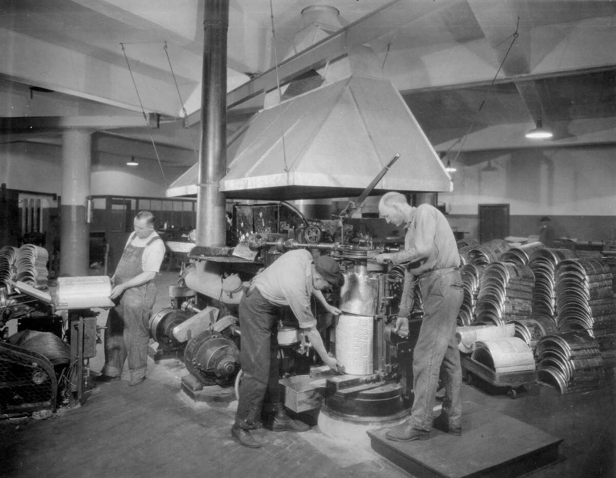 Stereotypers are at work at The Chronicle in preparation of the daily printing process in 1926.