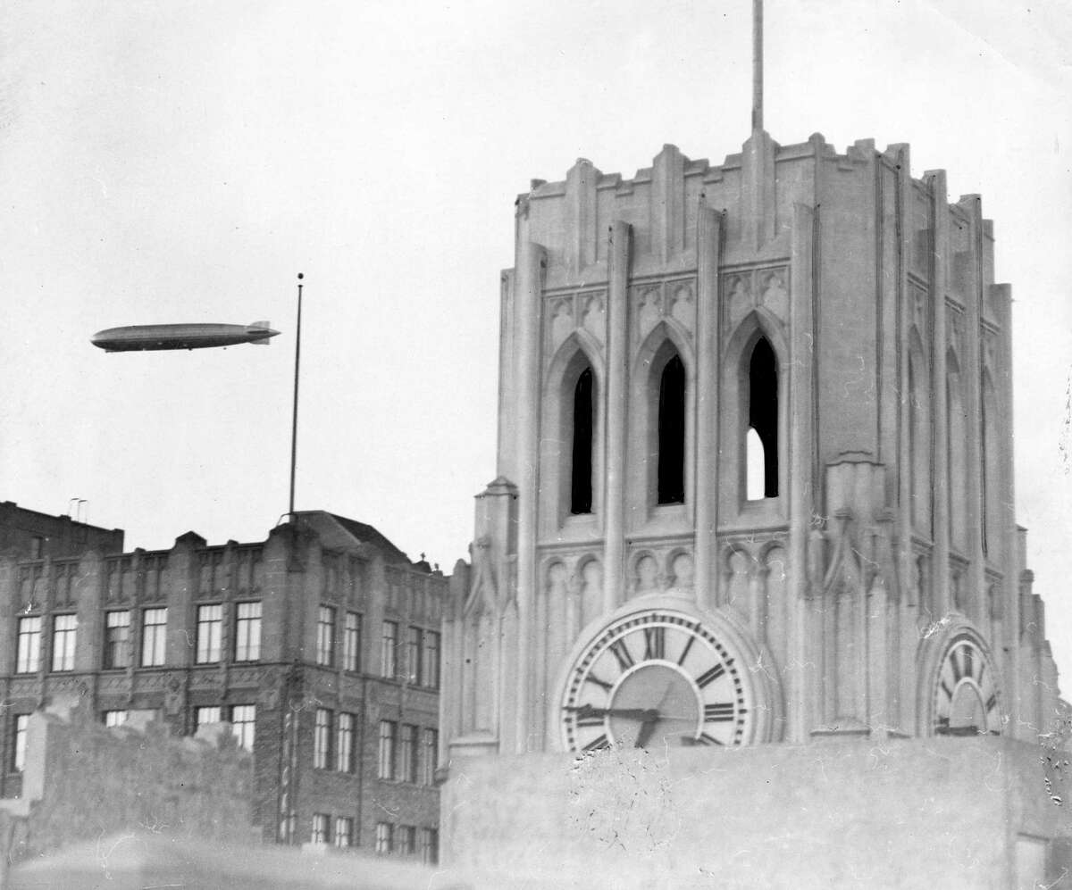 The Graf Zeppelin flies near The Chronicle building in 1929.