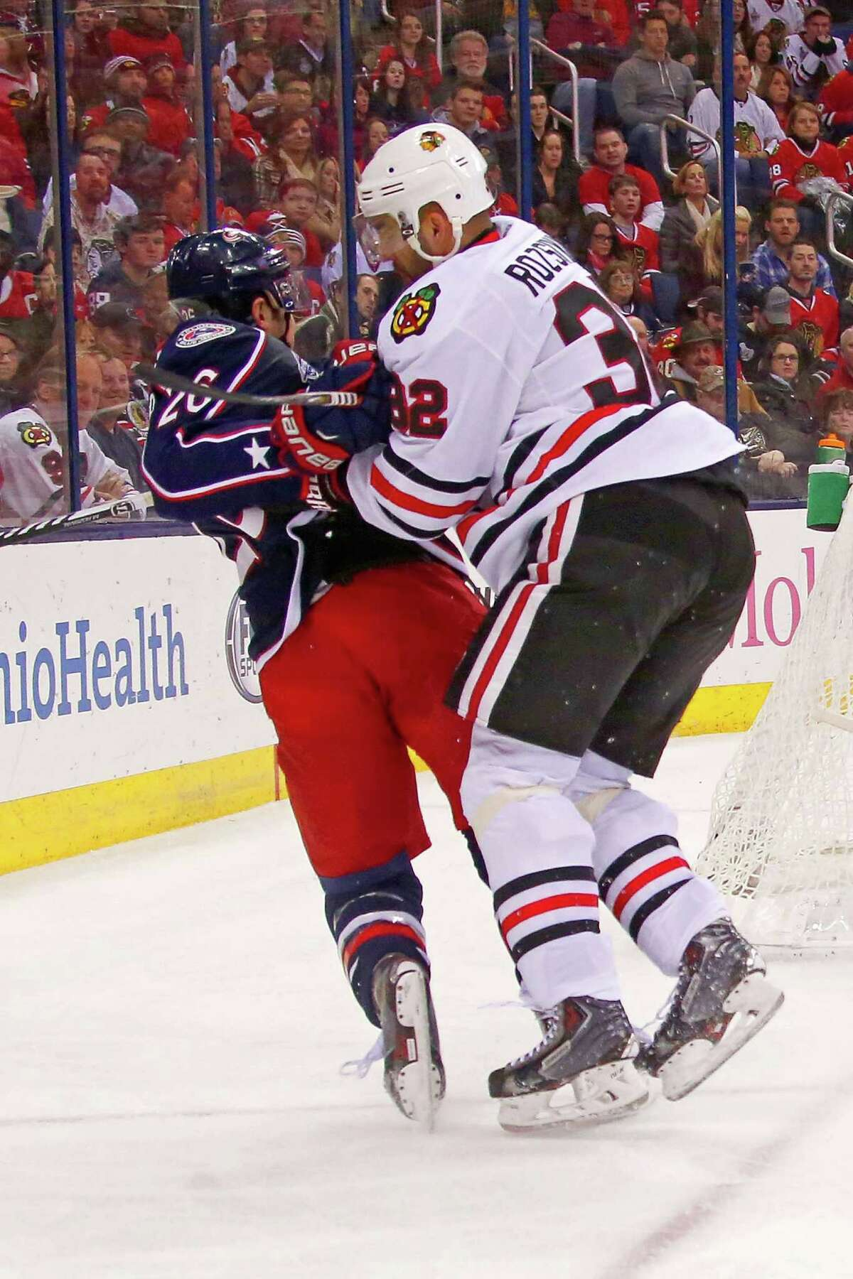 COLUMBUS, OH - DECEMBER 20: Michal Rozsival #32 of the Chicago Blackhawks checks Corey Tropp #26 of the Columbus Blue Jackets during the second period on December 20, 2014 at Nationwide Arena in Columbus, Ohio. (Photo by Kirk Irwin/Getty Images) ORG XMIT: 507048377