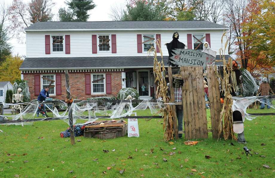 Rob Mauro works on setting up Halloween decorations in his front yard on Marilyn St. on Wednesday, Oct. 28, 2015 in Guilderland, N.Y. The decked out house is called Marilyn Mansion. (Lori Van Buren / Times Union) Photo: Lori Van Buren