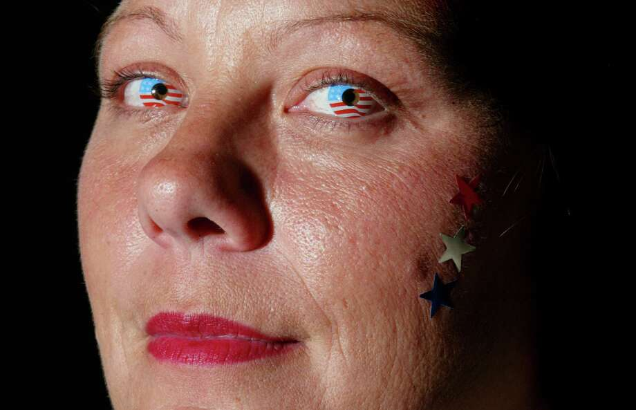Julia Leighton wears a pair of flag-colored contact lenses at an optometrist's office in Upper Arlington, Ohio, in this Sept. 11, 2002, file photo. The novelty lenses, which come in various colors and designs, are available by prescription. They also are increasingly being sold illegally by retailers and on the Internet without prescription. (AP Photo/Columbus Dispatch, Eric Albrecht) Photo: ERIC ALBRECHT / COLUMBUS DISPATCH