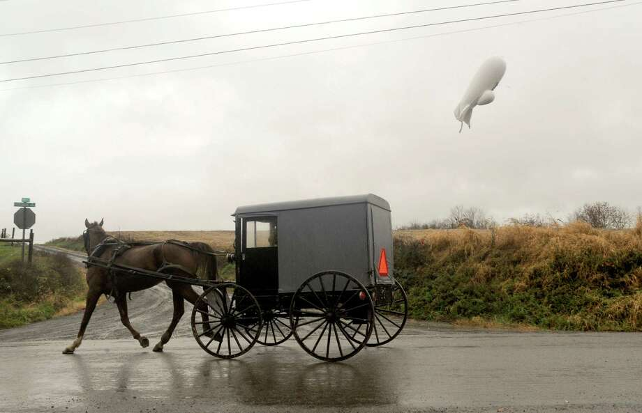 An unmanned Army surveillance blimp that broke loose Wednesday from its ground tether in Maryland floats at about 1,000 feet just south of Millville, Pa. It came down by itself later. Photo: Jimmy May, MBO / Bloomsburg Press Enterprise