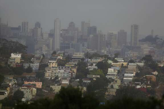 A view of downtown and Coit tower from the hills of John McLaren Park during patchy weather in San Francisco, Calif., on Wednesday, October 28, 2015.