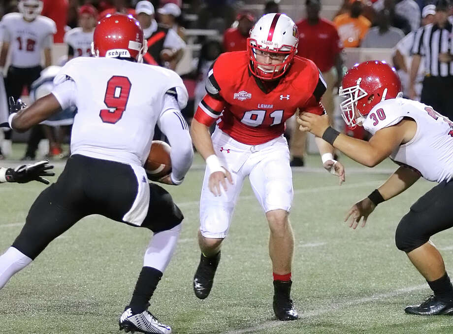 Logan Moss Orangefield's Logan Moss, 91, pressures the quarterback during the game between the Lamar Cardinals and Bacone College at Provost Umphrey Stadium Saturday night, September 5th, 2015 - photo provided by Kyle Ezell