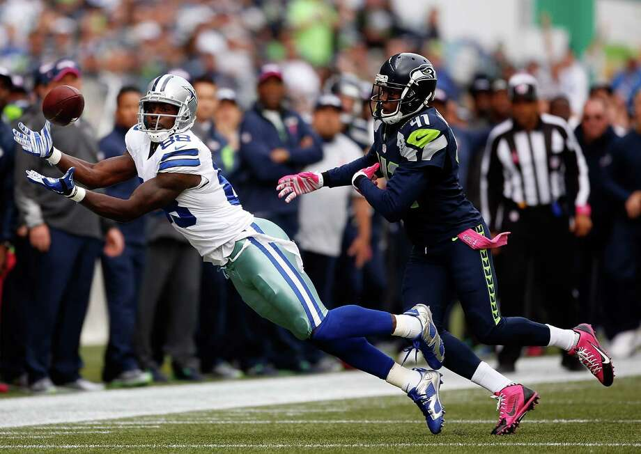 Wide receiver Dez Bryant of the Cowboys catches a pass against cornerback Byron Maxwell of the Seattle Seahawks during the first quarter of the game at CenturyLink Field on October 12, 2014 in Seattle, Washington. Photo: Otto Greule Jr, Getty Images / 2014 Getty Images