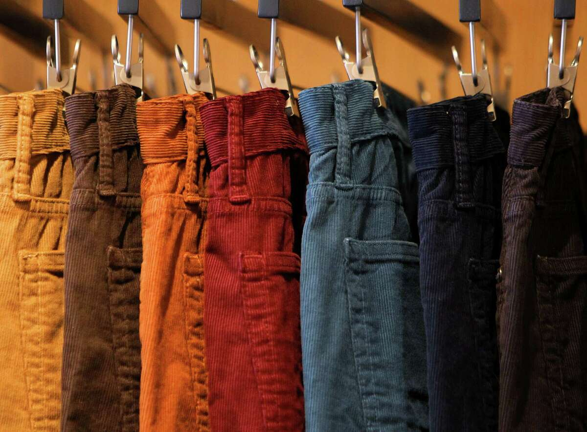 Different styles of pants hang at the new Bonobos Guideshop in River Oaks, Wednesday, Oct. 28, 2015, in Houston. The Guideshop allows men to come into the store, try clothes on, and then order the clothes online to be delivered to their door.