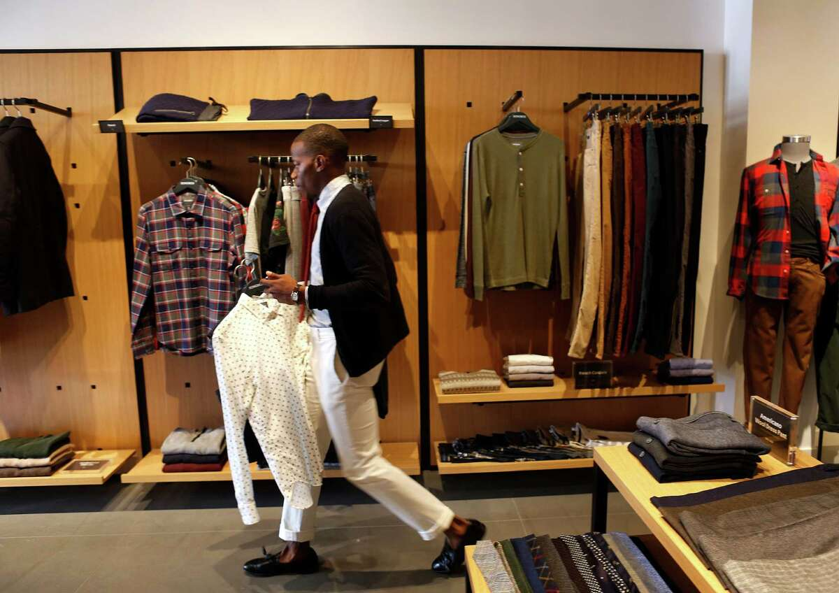 David Rochez, who writes a men's fashion blog, tries on clothes at the new Bonobos Guideshop in River Oaks, Wednesday, Oct. 28, 2015, in Houston. The Guideshop allows men to come into the store, try clothes on, and then order the clothes online to be delivered to their door.