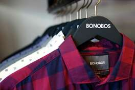 Shirts hang to be tried on at the new Bonobos Guideshop in River Oaks, Wednesday, Oct. 28, 2015, in Houston. The Guideshop allows men to come into the store, try clothes on, and then order the clothes online to be delivered to their door.