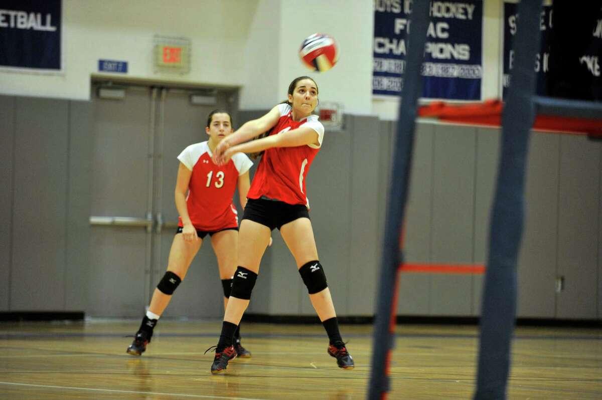 Caroline Beneville, of Greenwich, returns a Darien serve during a varsity volleyball match at Darien High School on Wednesday, Oct. 28, 2015.