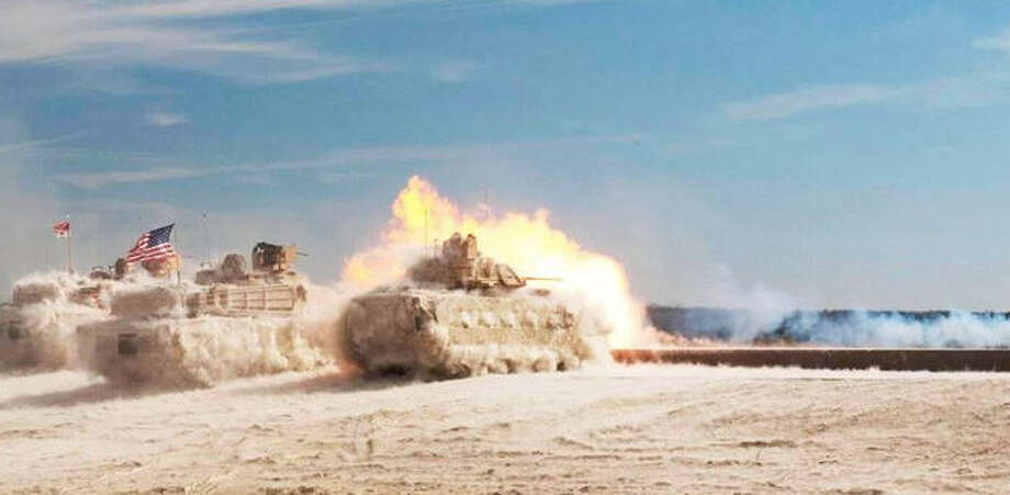 M1 Abrams tanks and an M2 Bradley training at Fort Hood