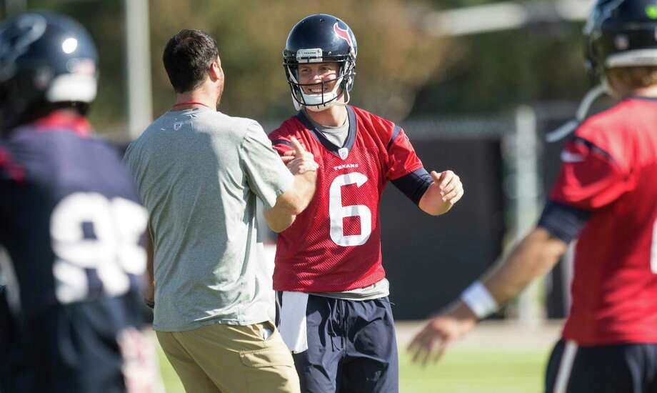 Quarterback T.J. Yates, right, renewed some acquaintances as he began his second stint with the Texans with Wednesday's practice. Photo: Brett Coomer, Staff / © 2015  Houston Chronicle
