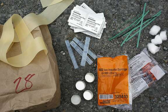 The contents of a bag from the city's needle exchange program seen in San Francisco, Calif., on Wednesday, October 28, 2015.