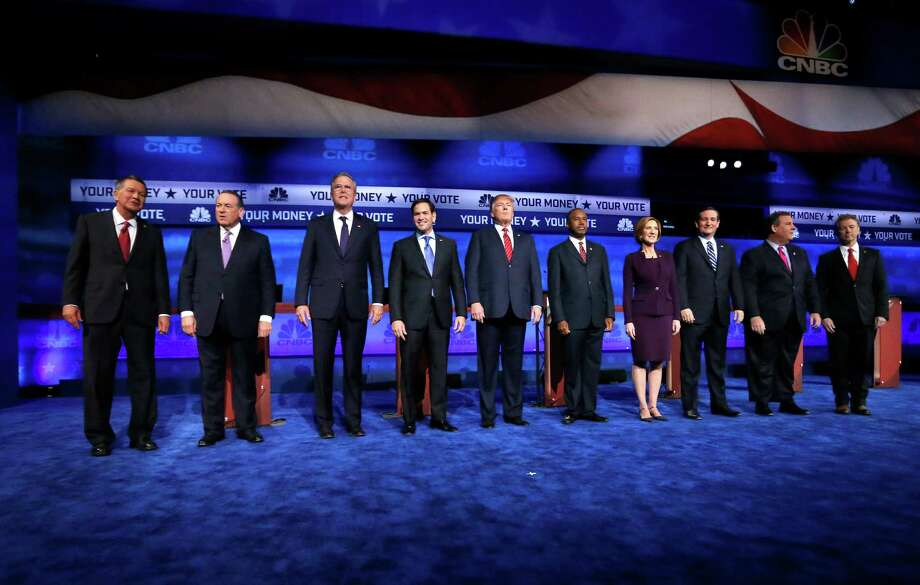 Republican presidential candidates, from left, John Kasich, Mike Huckabee, Jeb Bush, Marco Rubio, Donald Trump, Ben Carson, Carly Fiorina, Ted Cruz, Chris Christie, and Rand Paul take the stage during the CNBC Republican presidential debate at the University of Colorado, Wednesday, Oct. 28, 2015, in Boulder, Colo. (AP Photo/Brennan Linsley) Photo: Brennan Linsley, Associated Press / AP