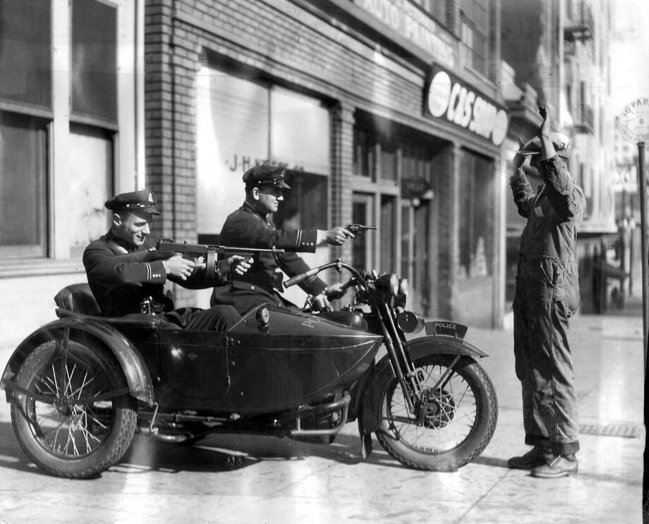 Police officers in a new department motorcycle and sidecar in October 1929. Photo: Chronicle File