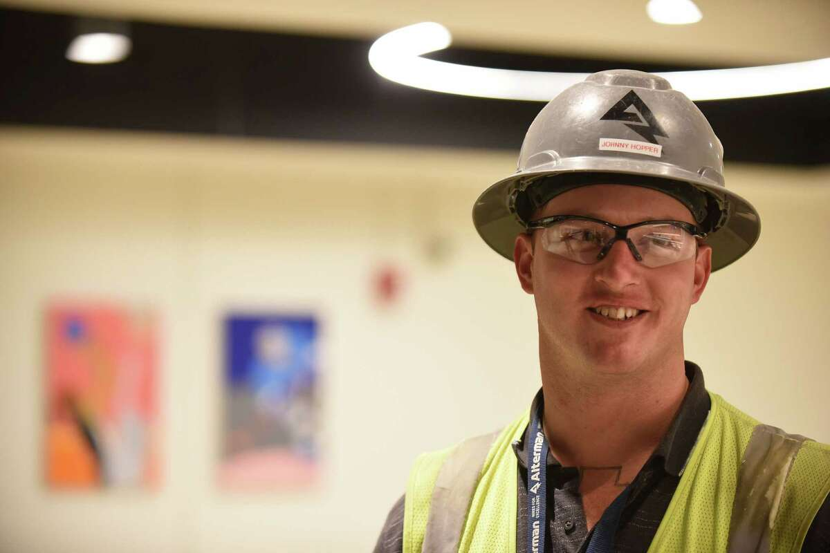 """Electrician John Hopper, who has a criminal past, got his job at the county-sponsored """"Second Chance Job Fair"""" at the AT&T Center earlier this year."""