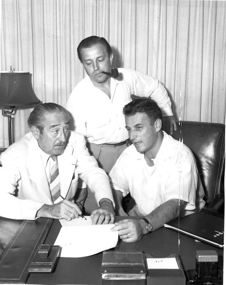 The Hollywood 10, blacklisted after appearing before the House UnAmerican Activities Committee This is Adolph Menjou signs contract that includes him shaving his moustache for $10,000,  Edward Dmytryk (center) and Stanley Kramer watch Photo ran01/30/1966 , Datebook pg. 3 Handout Photo: Handout