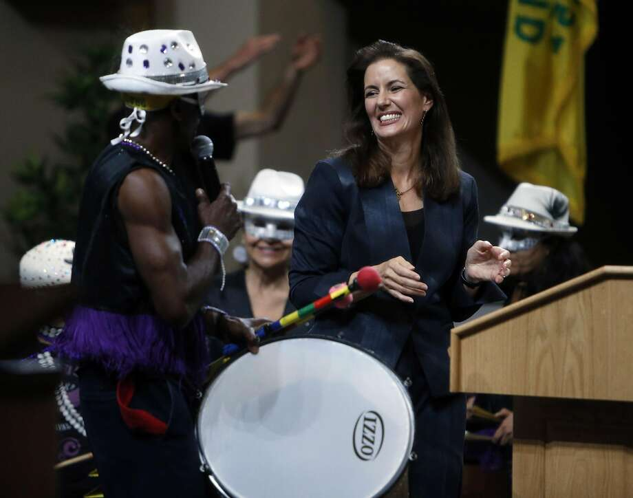 """Oakland Mayor Libby Schaaf reacts to a band playing after her """"State of the City"""" address at City Hall in Oakland, Calif., on Wednesday, October 28, 2015. Photo: Scott Strazzante, The Chronicle"""