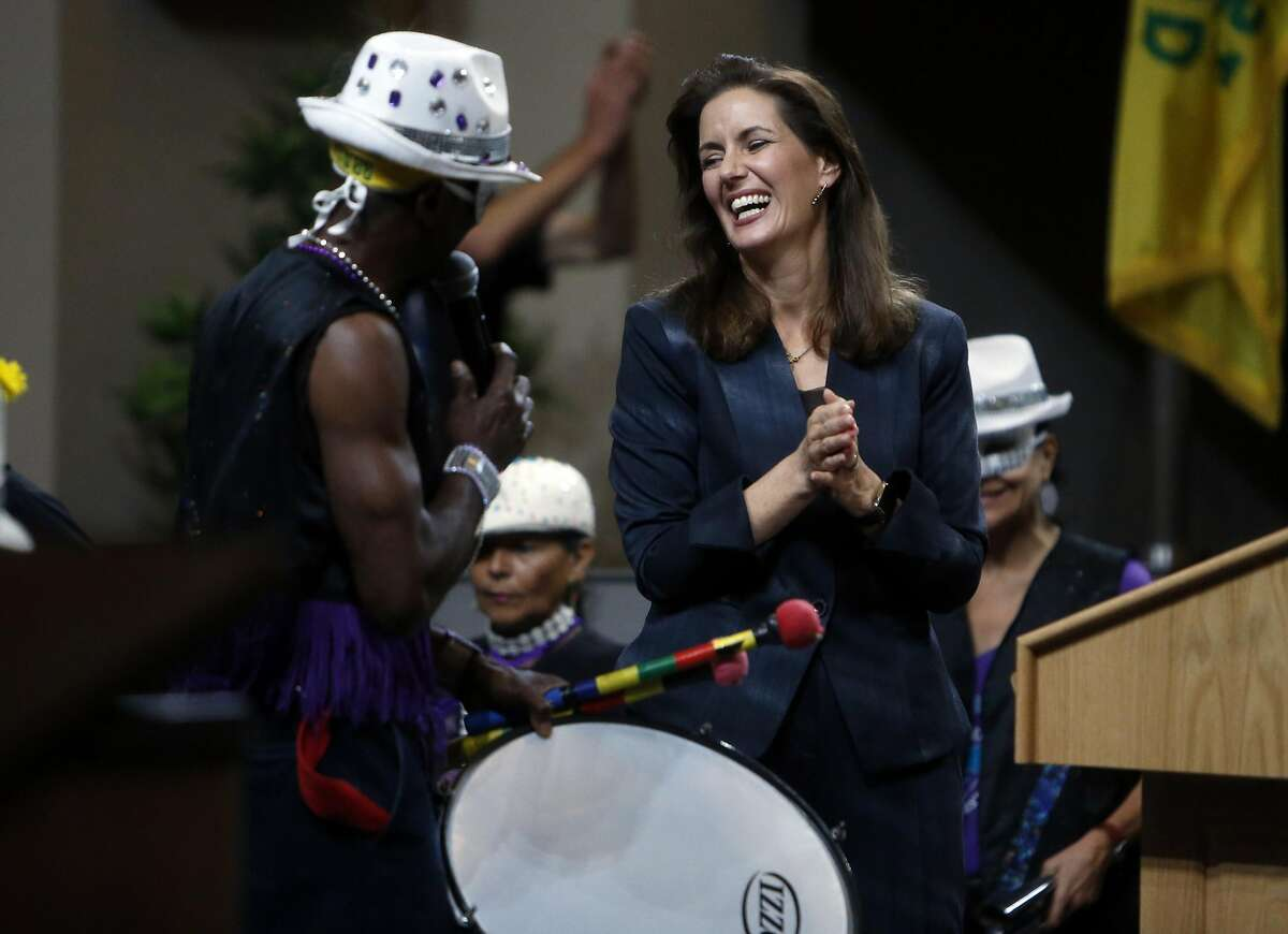 Oakland Mayor Libby Schaaf reacts to a band playing after her