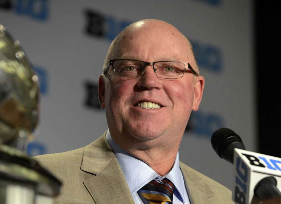 FILE - In this July 31, 2015, file photo, Minnesota head coach Jerry Kill speaks to the media during the NCAA college Big Ten Football Media Day in Chicago. Minnesota coach Jerry Kill is retiring because of health reasons, bringing to an abrupt end his efforts to rebuild the Golden Gopher football program. The surprising announcement came one day after Kill missed a scheduled meeting with the media. Kill has epilepsy, and had to take a leave of absence from the team in 2013 while dealing with seizures. (AP Photo/Paul Beaty, File) ORG XMIT: NY160 Photo: Paul Beaty / FR36811 AP