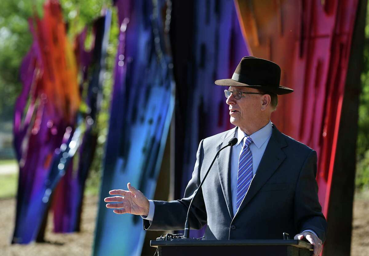 Bexar County Judge Nelson Wolff addresses the people gathered to dedicate the public art installation.