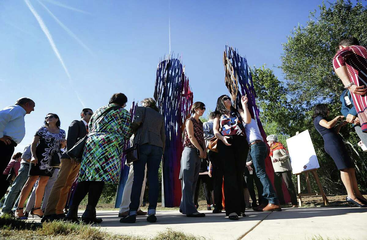 """The San Antonio River Foundation and local leaders gathered along the Mission Reach of the San Antonio River to dedicate the art installation of """"Whisper"""" by renowned Belgian artist Arne Quinze on Wednesday, Oct. 28, 2015. The piece, Quinze's first in the U.S., serves as a portal between the river and Mission San Juan Capistrano."""