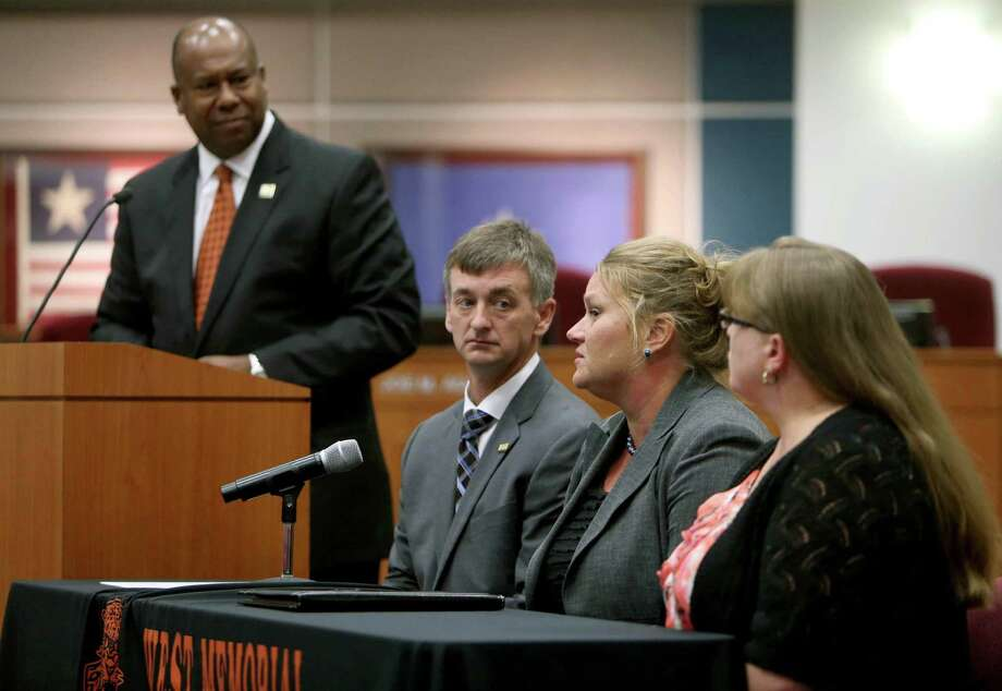 Katy super-intendent Alton Frailey, standing, and other school officials discuss a junior high student's complaint that an assignment was aimed at questioning the existence of God. Photo: Gary Coronado, Staff / © 2015 Houston Chronicle